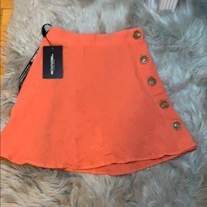 Peach spice button mini skirt